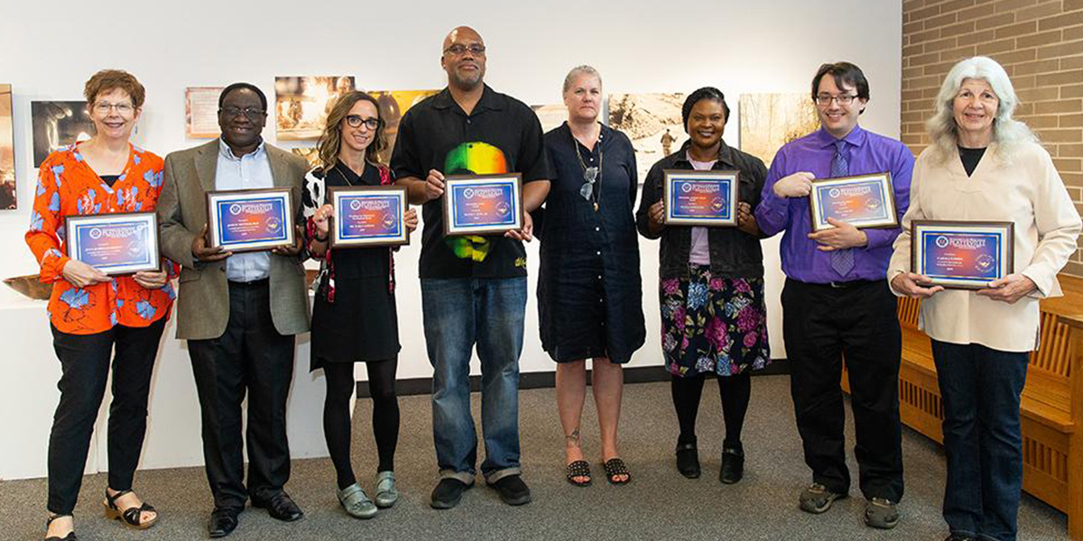 Left to right: Dr. Joan Riedle, Dr. John Nkemnji, Dr. Kara Candito, Dr. Frank King, Jr., Dr. Melissa Gormley, Dr. Shan Sappleton, Dr. Will LeSuer, and Carolyn Fries.