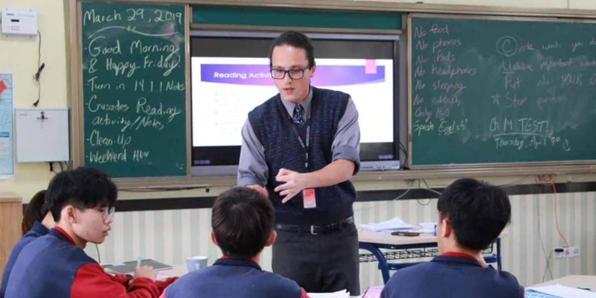 Charlie Schoenberg teaching at Guangwai-Pacelli High School