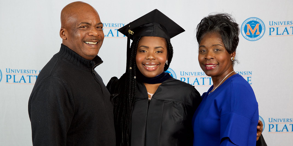 Asia attended the Division of Professional Studies' spring 2018 commencement reception with her parents.