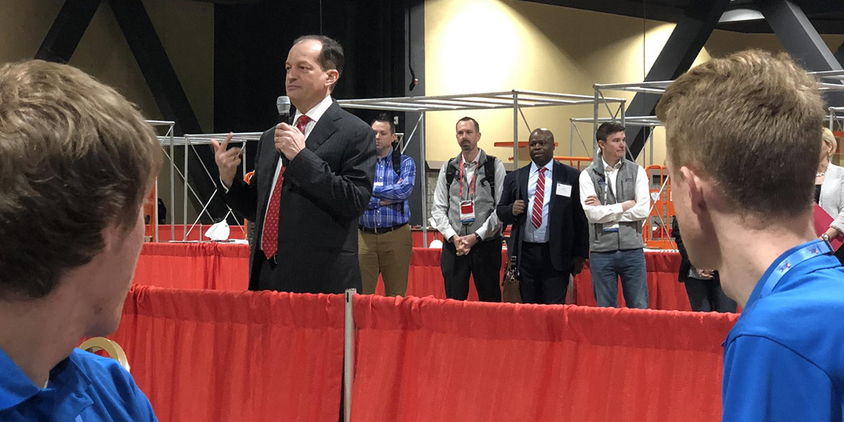 United States Labor Secretary Alexander Acosta addresses the competitors.
