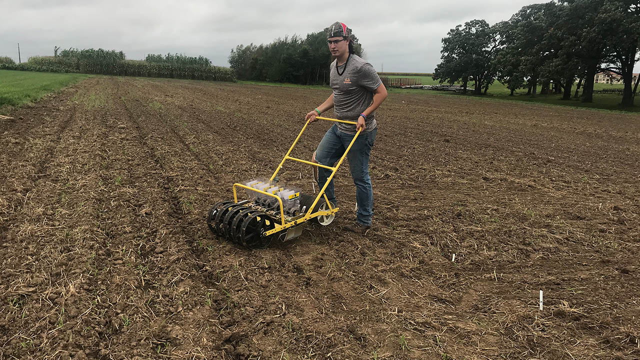 Hunter Jesberger plants 10 varieties of pennycress at the Lancaster Agricultural Research Station.