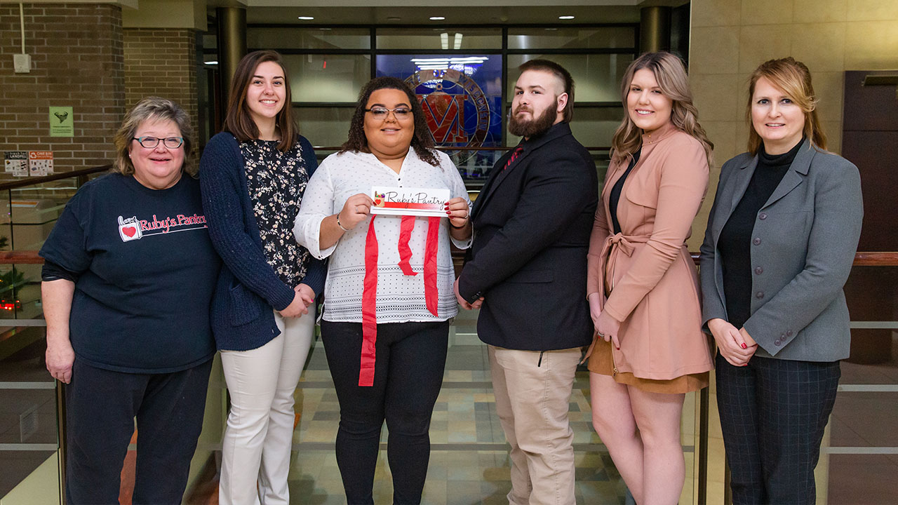Pictured left to right are Deb Putnam, Murphy Bleymeyer, Raiven Breseman, Clay Spooner, Sydney Williams and Valerie Gill, MSW, LISW