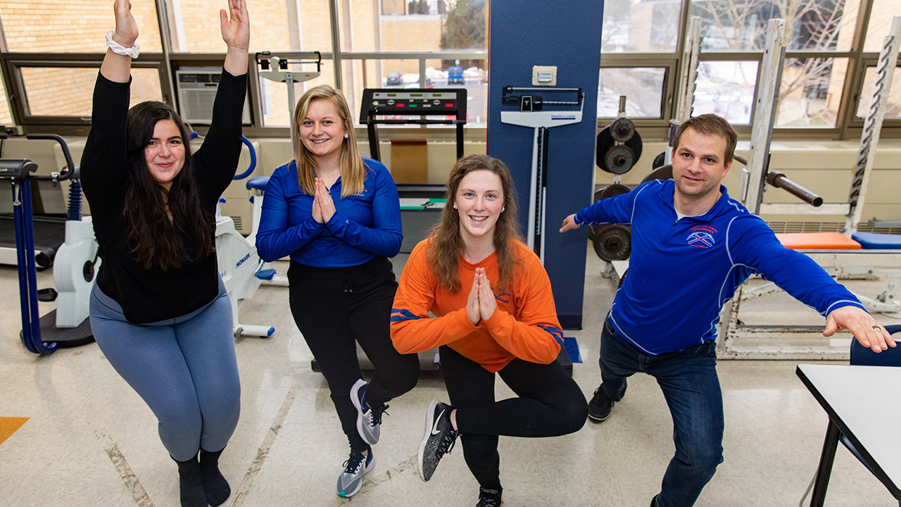 Monica Radtke, Brooke Kunkel, Ann Larson, and Professor Cowley reminisce about their yoga study.