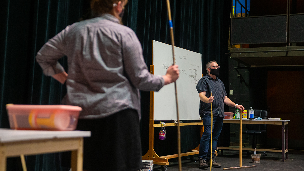 Jeffrey Strange, associate professor, works with students on scenic design.